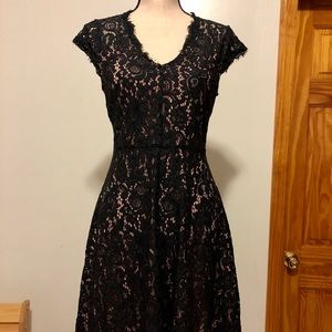 Cute, black lace dress with pink lining